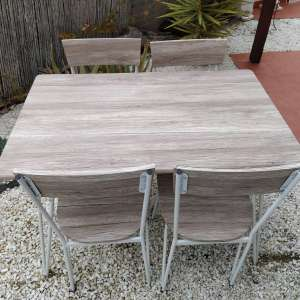 For sale: Brand new table and 4 chairs