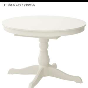 For sale: White round/0blong dining table